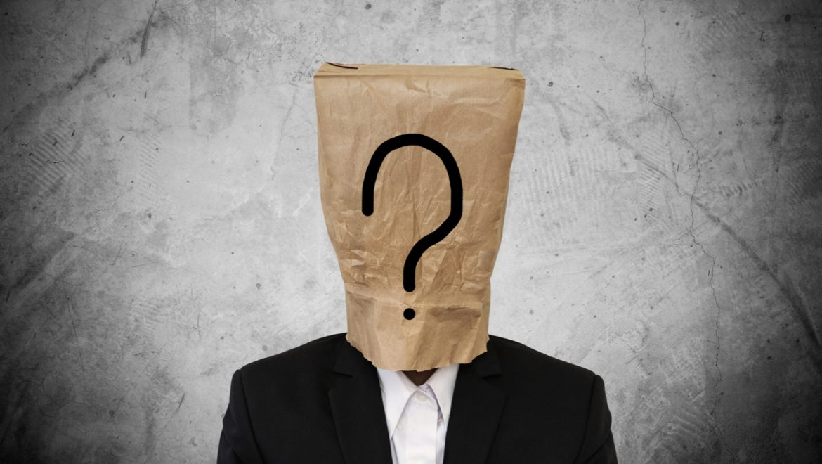 man with paper bag over head